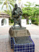 statue of famed director John Huston on the Cuale river island