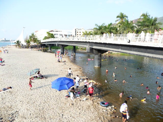 new malecon over the cuale river - gay puerto vallarta travel